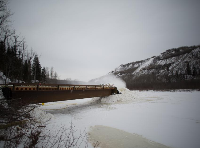 Constructing a temporary ice bridge across the Moberly River. (March 2017)
