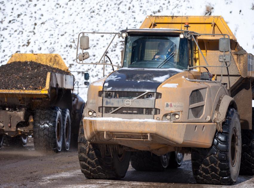 Trucks hauling material. (March 2016)
