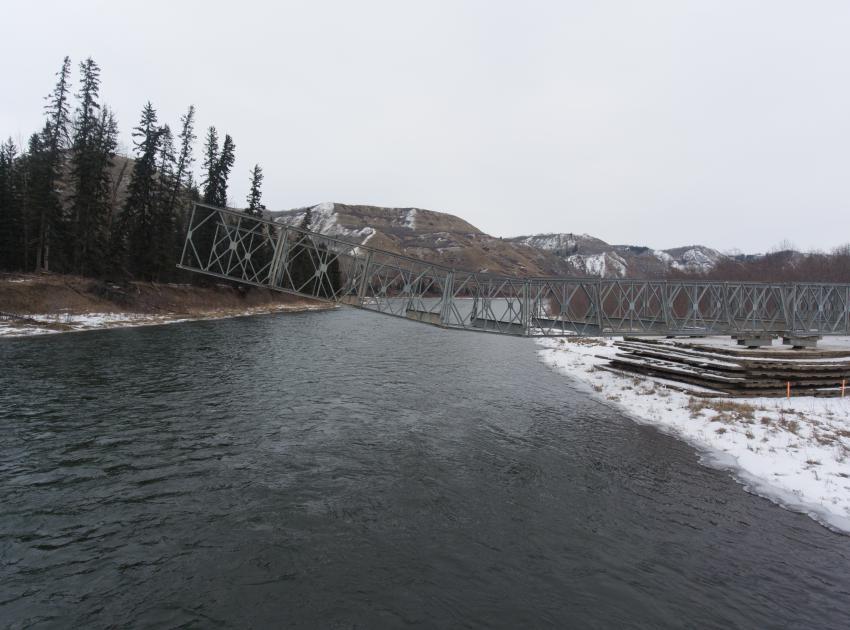 Constructing a temporary bridge to Tea Island. (March 2017)