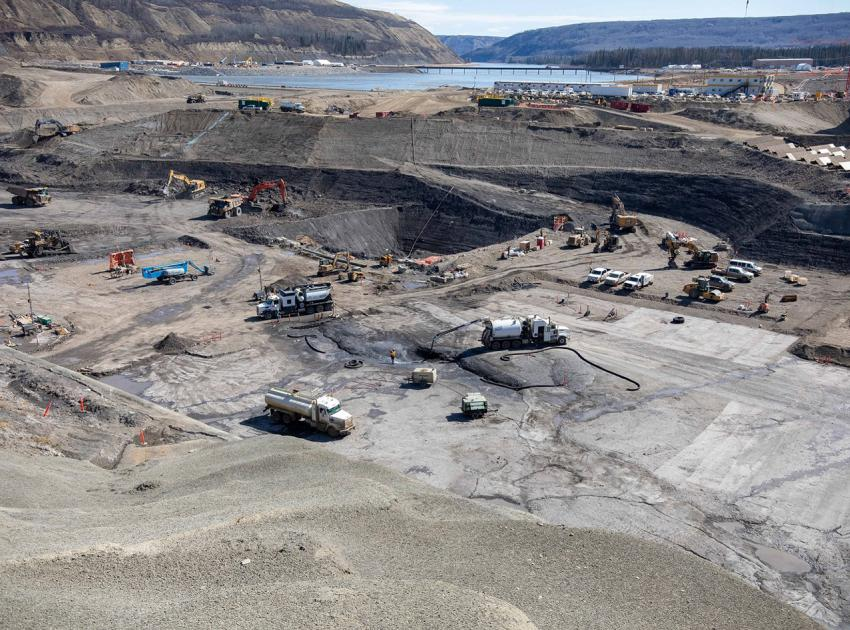 Crews excavate and prepare the dam core area where the earthfill dam will be constructed. (June 2021)