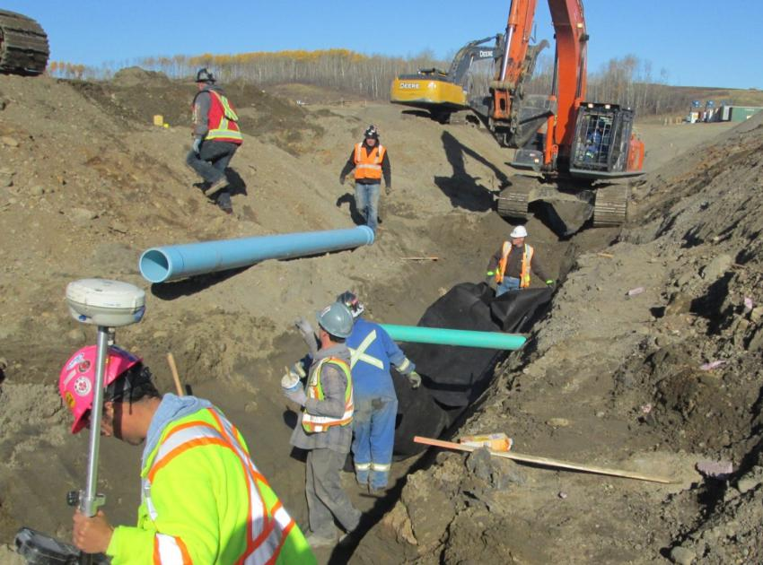 Petrowest crew installing water line