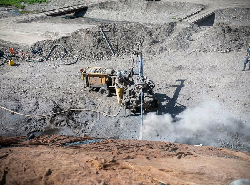 Drilling to install anchor bolts is underway at the 1.5-kilometre-long Highway 29 realignment segment at Dry Creek. (June 2021)