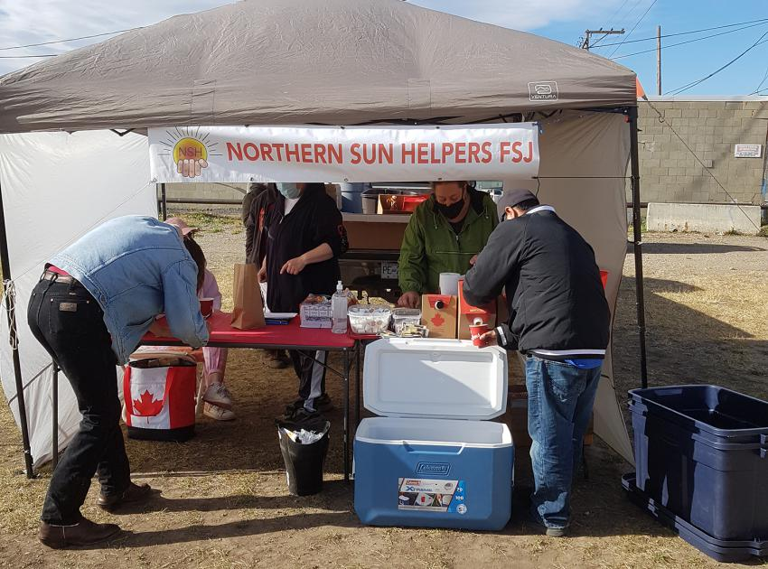 Members of the Northern Sun Helpers Society provide meals to vulnerable residents in Fort St. John.jpg
