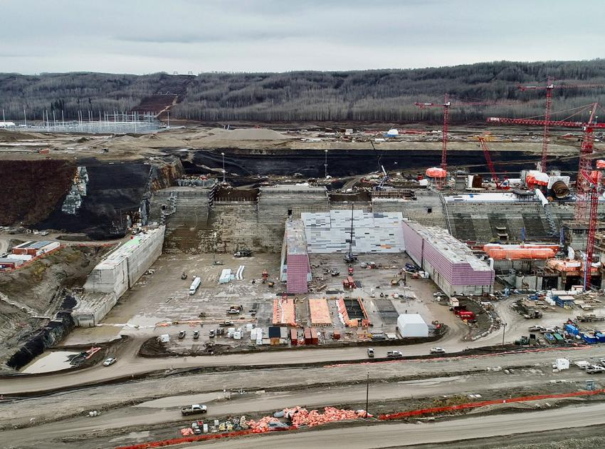 Looking south at the spillways buttress (left) and the Site C powerhouse, under construction (right). (October 2019)
